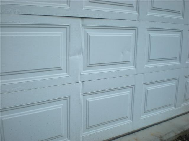 Reparing Dented Garage Door Panels By Southwest Garage
